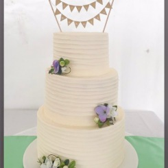 3 tier scraped buttercream effect with fresh flowers